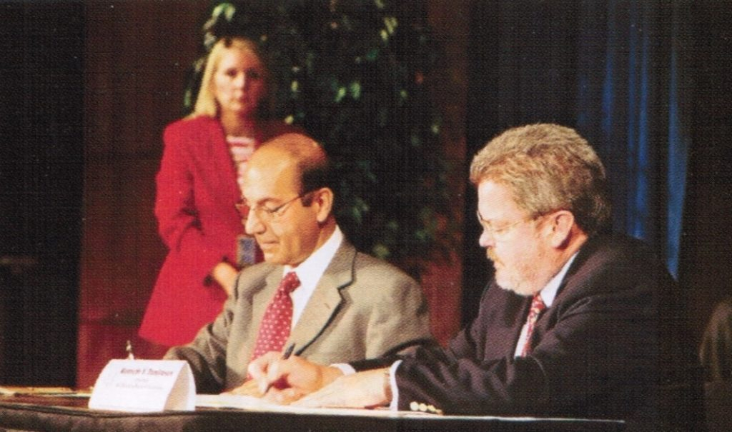 Broadcasting Board of Governors (BBG) Chairman Kenneth Y. Tomlinson and Afghan Minister of Information and Culture Dr. Makhdoom Raheen sign the U.S.-Afghanistan Radio Agreement in Washington, D.C. on October 3, 2002. Photo from Afghanistan Project BBG 2002 Annual Report.